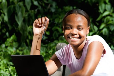 Smiling girl with a laptop